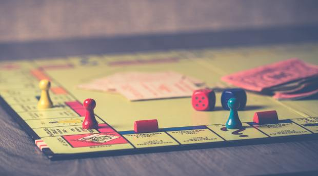 monopoly-board-game-on-brown-wooden-tabletop-776654